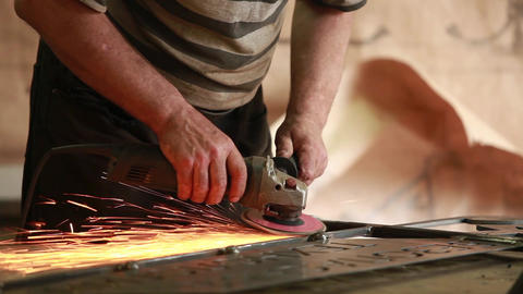 Hands using angle grinder Footage