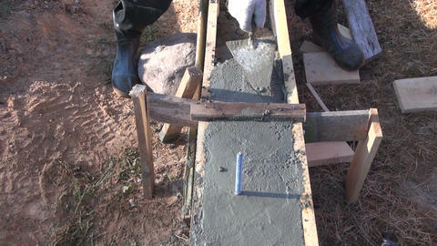 Man cementing foundation with trowel Footage