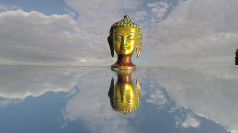 Buddha head sculpture on mirror and sky clouds, time lapse 4K Footage