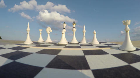 Chess board with figures and clouds concept, time lapse 4K Footage