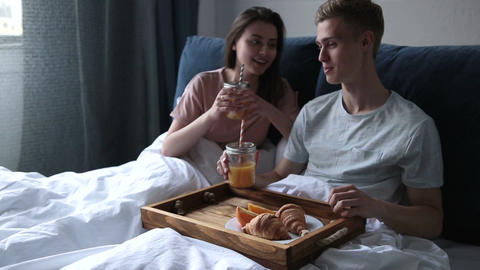 Young couple enjoying romantic breakfast in bed Footage