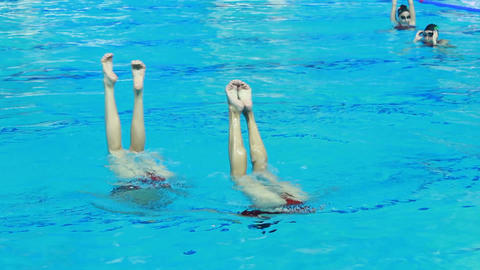 Young Slim Girls Swimmers Train in Synchronized Swimming Footage