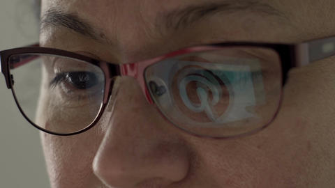 Pinterest Logo Reflection in Glasses of Middle Aged Female Footage