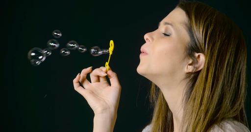 Pretty Woman Blowing Bubbles Slow Motion Footage