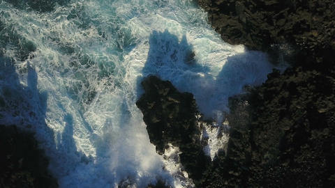 Aerial Of Waves Crashing Tnto The Shore Footage