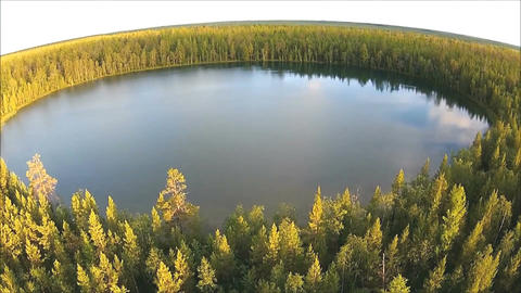 Aerial view of round lake and the forest