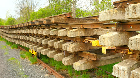 Used sleepers stock on wagon in depot. Old, dirty and rusty used concrete and wo Footage