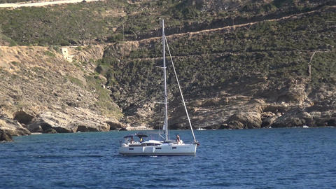 Yacht in a Rocky Bay Footage