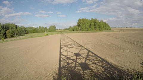 Shadow of electrical pylon on fields, time lapse 4K Live Action