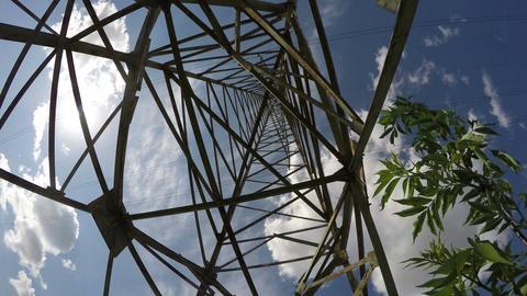 Electrical pylon construction against blue cloudy sky, time lapse 4K Footage