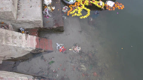 parts of festive sculpture lying in the bottom of Ganges river Footage