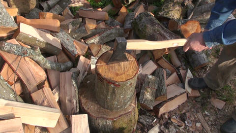 Farmer chopping wood outdoors Footage