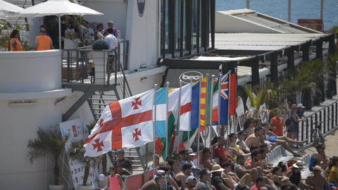 International Audience And Flags By The Beach ビデオ