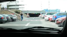A man drives a car - enter into the car park - timelapse Footage