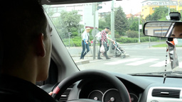 A man drives a car - people crossing the street at the crossing Footage