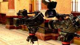 television cameras - cameraman in background (studio) - historic interior in bac Footage