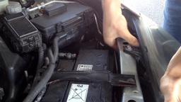 man repairs motor in the car Footage