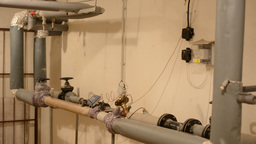 room with piping and measurement of water Footage