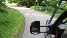 car travels on a road in the countryside(nature) Footage