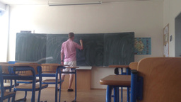 "school class - empty - man writes on a blackboard ""end of school"" Footage"