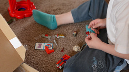 child(small boy) plays with toys in the room - toys(construction set) Footage