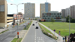 housing development (high-rise block of flats) with the road - bus stop and gras Footage