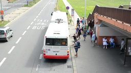 Bus Stop - People Wait For The Bus - Bus Arrives And Departs stock footage