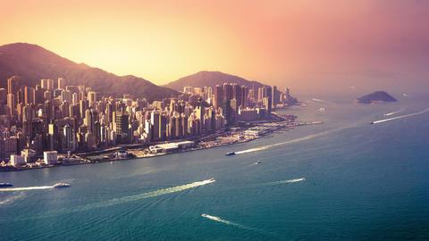 Aerial panorama view of Hong Kong Island at sunset. Modern financial and cultura Footage
