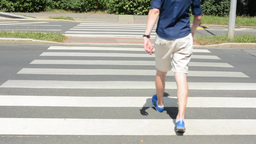 man goes across the street (pedestrian crossing) Footage