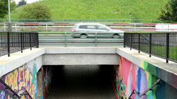 graffiti on the wall - pedestrian underpass and cars on the road Footage