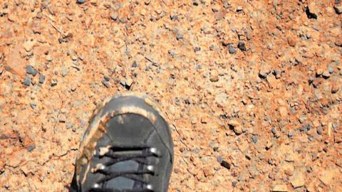 Hiking across cracked desert landscape. Slow motion. Global warming concept Footage