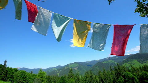 Mountain landscape with Buddhist praying flags fluttering in the wind Footage