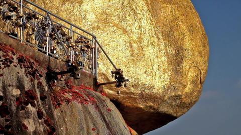 Golden Rock with row of traditional golden wind bells. Myanmar Footage