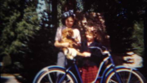 1952: Sister enjoy new puppy on sitting on bike seat Live Action