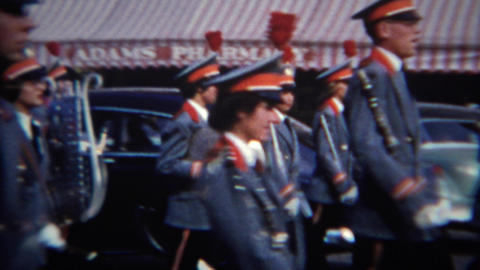 1952: Blue formal marching band closeup past pharmacy barber shop Footage