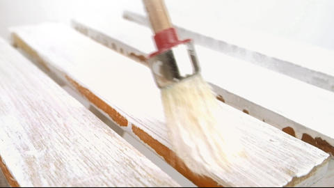 Painting old wooden furniture with a brush 3 Footage