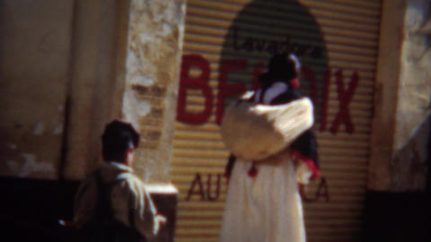 1951: Mexican street scene people lined up waited for laundromat to open Footage