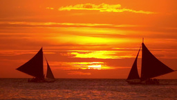 Tropical sunset. Sail boats silhouettes on ocean horizon. Boracay, Philippines Footage