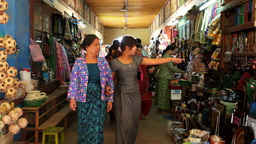 Burmese people and foreign tourists shopping souvenirs at Bagan, Myanmar Footage