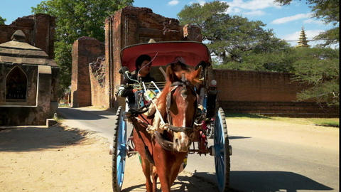 Myanmar man driving the horse wagon with tourist at Bagan, Myanmar (Burma) Footage