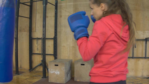 Slow Motion Beautiful Young Girl Practicing Boxing In A Gym Footage