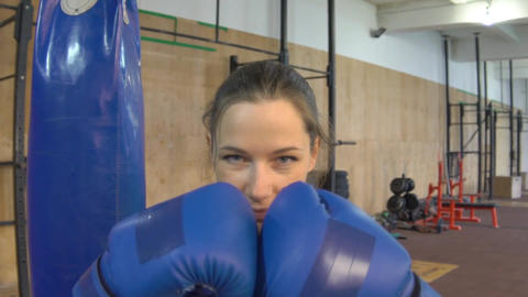 Sexy Girl Punching Gloves Together, Closeup Footage