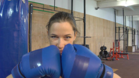 Slow Motion Sexy Girl Punching Gloves Together, Closeup Footage