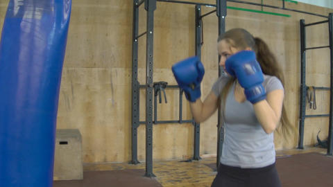Slow Motion Female Martial Artist Or Boxer Training At The Gym Footage