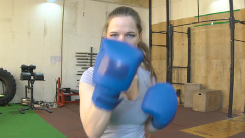 Woman Boxing And Look In The Camera Footage