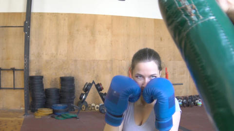 Slow Motion A Young Woman Girl Holding Boxing Paws. Trains With The Coach Footage