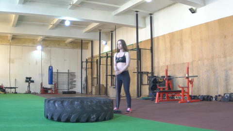Fly Around Woman Doing Crossfit Exercises. Hitting Tire Footage