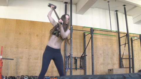 Slow Motion Woman Doing Crossfit Exercises. Hitting Tire Footage