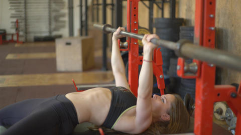 Young Sporty Fitness Woman With Barbell Live Action
