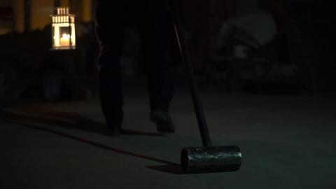 A Man Maniac With Hammer Walks Down The Dark Corridor Footage